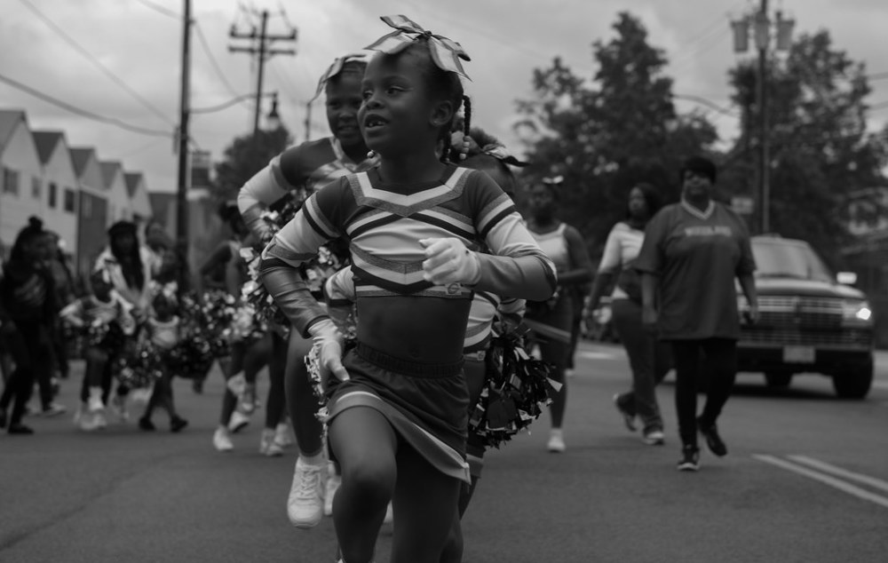 Little girl marching in a parade